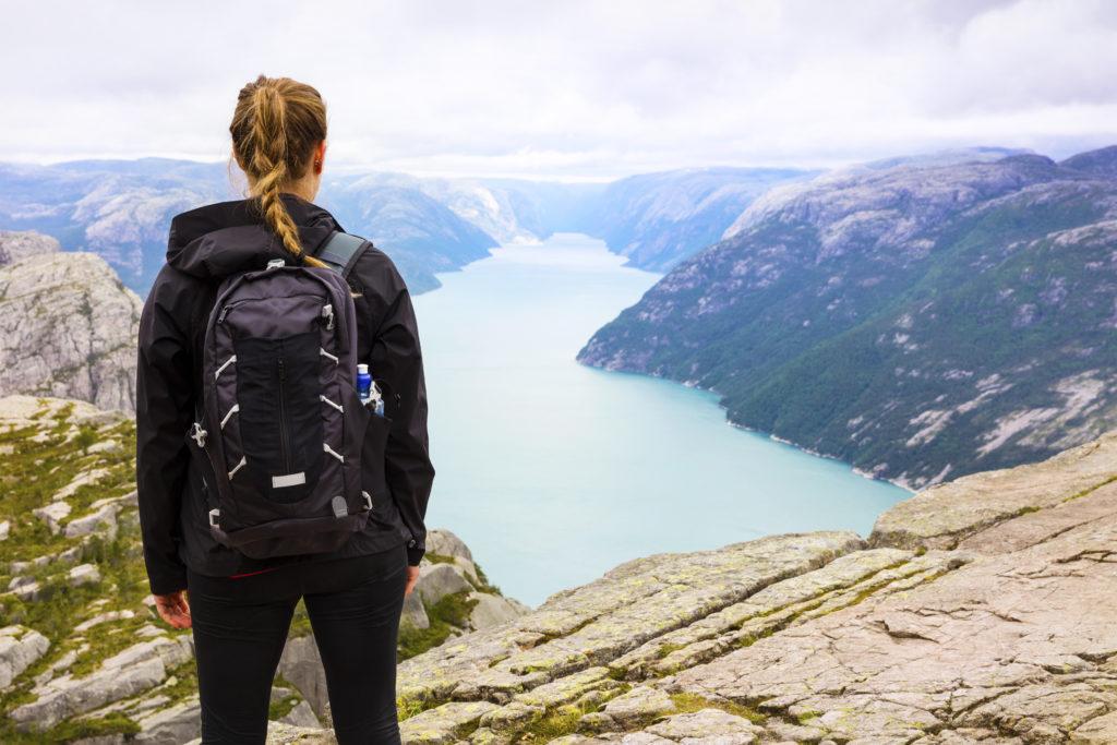 Woman hiking at the Preikestolen cliff in lysefjorden Norway